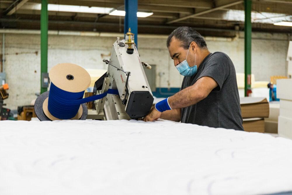 Texas Mattress Makers Handmaking mattresses in factory